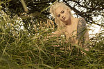 outdoor photoshoot, with partial nudity