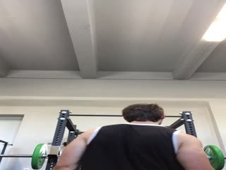 Pumping shoulders at gym